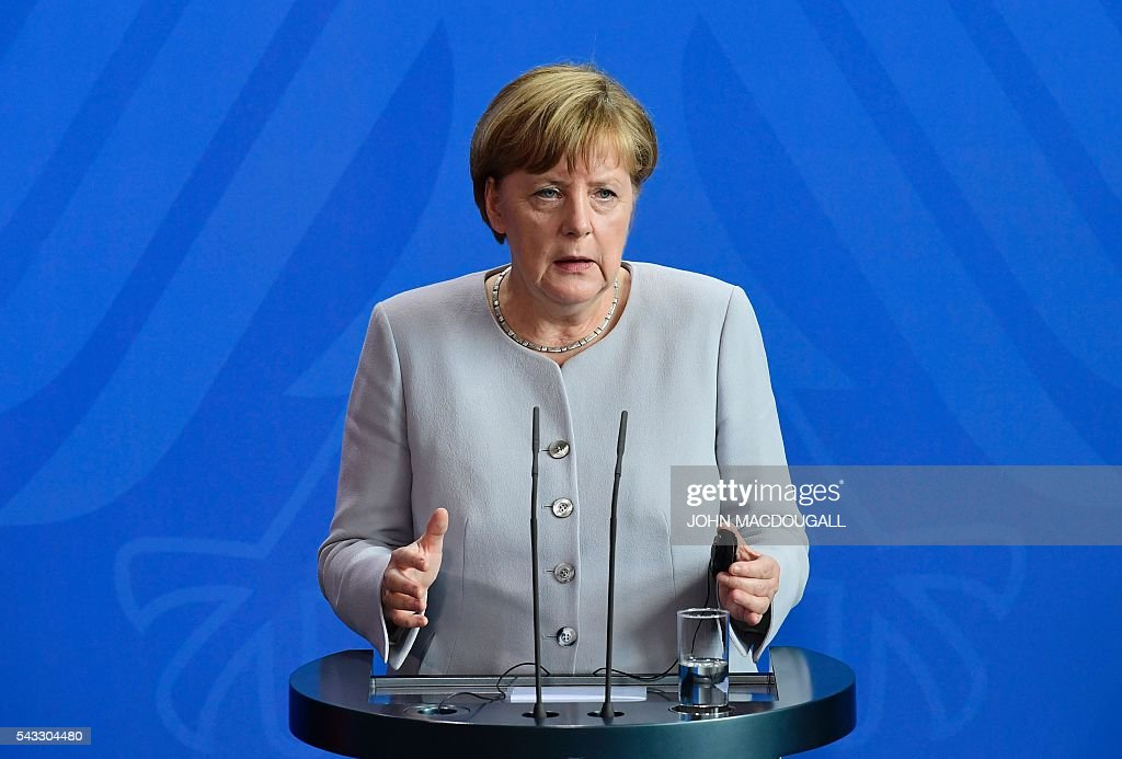 German Chancellor Angela Merkel addresses a joint press conference with the French President and Italy's Prime Minister ahead of talks following the Brexit referendum at the chancellery in Berlin, on June 27, 2016. Britain's shock decision to leave the EU forces German Chancellor Angela Merkel into the spotlight to save the bloc, but true to her reputation for prudence, she said she would act neither hastily nor nastily. / AFP / John MACDOUGALL