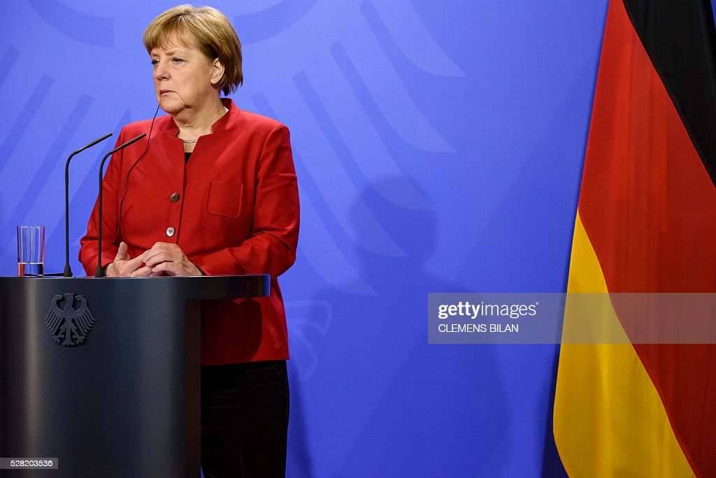 German Chancellor Angela Merkel addresses a press conference after bilateral talks with Japanese Prime Minister at the state guest house 'Schloss Meseberg' in Gransee in Brandenburg near Berlin, on May 4, 2016. / AFP / CLEMENS