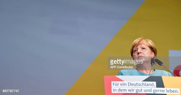 German Chancellor Angela Merkel addresses an election campaign rally of the Christian Democratic Union in Heilbronn southern Germany on August 16...