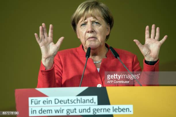 German Chancellor Angela Merkel addresses an election campaign rally of the Christian Democratic Union in Bergisch Gladbach western Germanz on August...