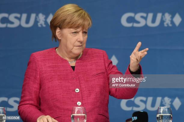 German Chancellor Angela Merkel addresses an election campaign rally in Munich southern Germany on September 22 2017 / AFP PHOTO / Christof Stache