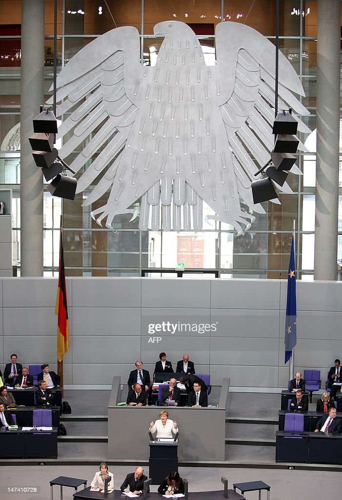 German Chancellor Angela Merkel addresses German lawmakers before they vote on the EU fiscal pact and permanent ESM bailout fund at the lower...