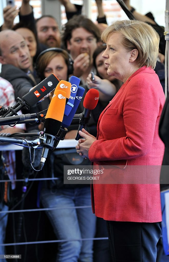 German Chancellor Angela Merkel addresses journalists as she arrives for a statutory Summit of the European People's Party (EPP), on June 16, 2010 in Meise, near Brussels, on the eve of an European Council gathering EU's heads of state. During the one-day meeting, EU leaders are expected to adopt 'Europe 2020', the new strategy for jobs and growth, and will also discuss the forthcoming G 20 summit, economic governance and post-Copenhagen climate strategy.