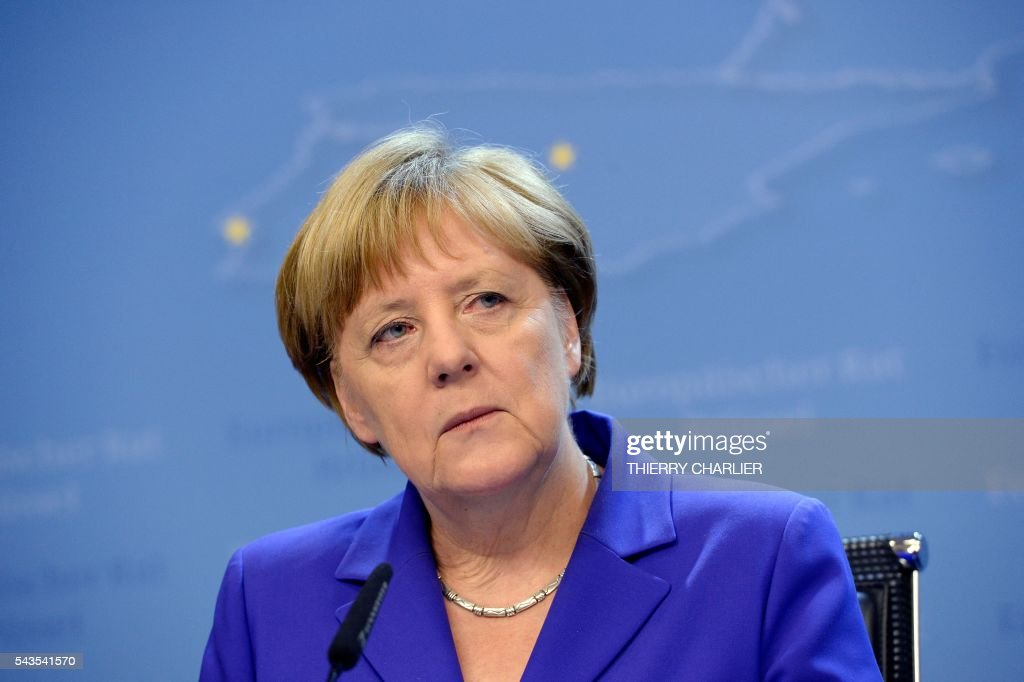 German Chancellor Angela Merkel addresses the media at the end of the second day of an EU - Summit at the EU headquarters in Brussels on June 29, 2016. EU leaders agreed on June 29 that Britain cannot have access to the single market after leaving the union without accepting the bloc's rules on free movement, president Donald Tusk said, as Merkel warned that London could not 'cherry-pick' the terms of the exit negotiations. / AFP / THIERRY