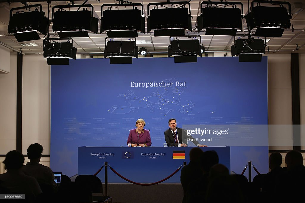 German Chancellor <a gi-track='captionPersonalityLinkClicked' href=/galleries/search?phrase=Angela+Merkel&family=editorial&specificpeople=202161 ng-click='$event.stopPropagation()'>Angela Merkel</a> (L) addresses the media at the headquarters of the Council after reaching a deal on the budget for 2014-20 on February 8, 2013 in Brussels, Belgium. EU leaders have set out the framework for agreeing on a 2014-2020 EU budget, during talks that continued through the night at the European Council meetings in Brussels. The historic deal would see a 34.4 billion Euros cut to EU spending over the next 7 year period.