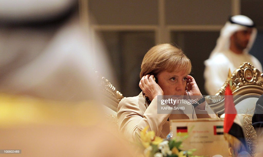 German Chancellor Angela Merkel adjusts her headset as she attends a meeting of the UAE-Germany Joint Economic Commission in Abu Dhabi on May 25, 2010. Merkel called for the United Arab Emirates to exert its influence to encourage a nuclear-free Iran and held talks on Middle East peace efforts.