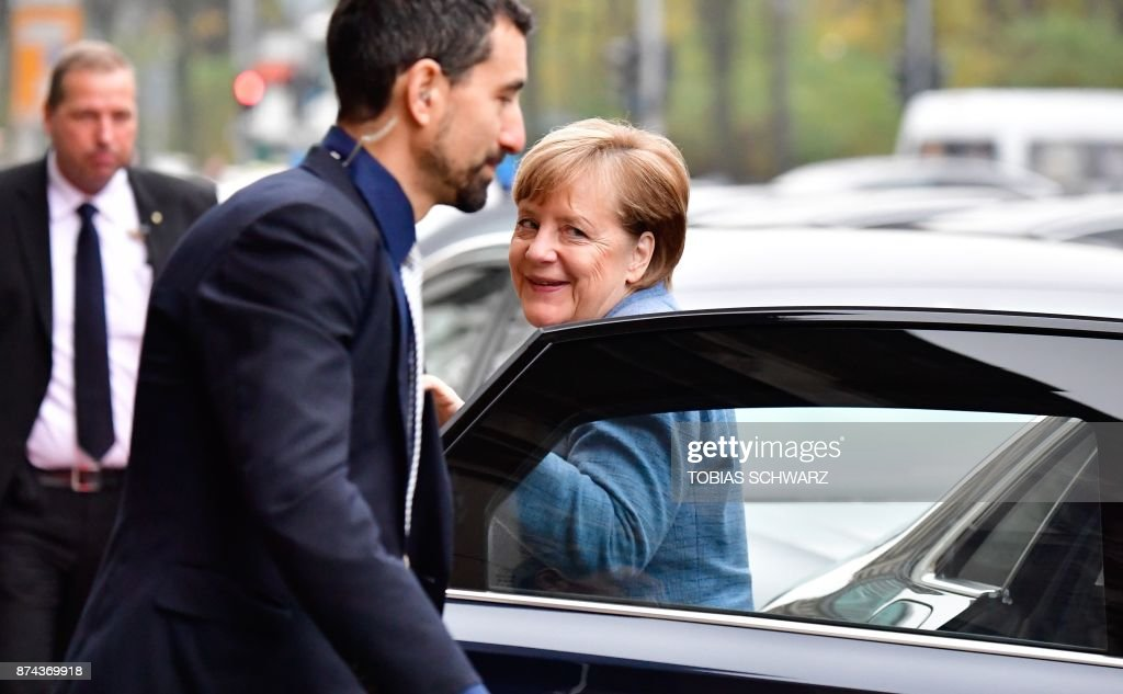 German Chancellor Angela Merkel, also leader of the conservative Christian Democratic Union (CDU) party, arrives for further exploratory talks with members of potential coalition parties to form a new government on November 15, 2017 in Berlin. / AFP PHOTO / Tobias SCHWARZ