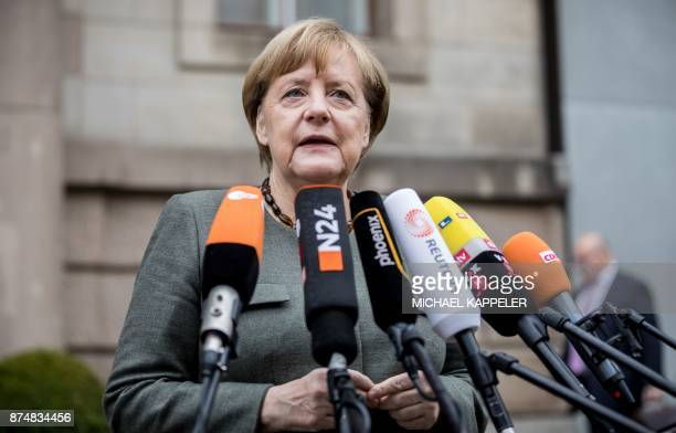 German Chancellor Angela Merkel also leader of the conservative Christian Democratic Union party gives a statement as she arrives for further...