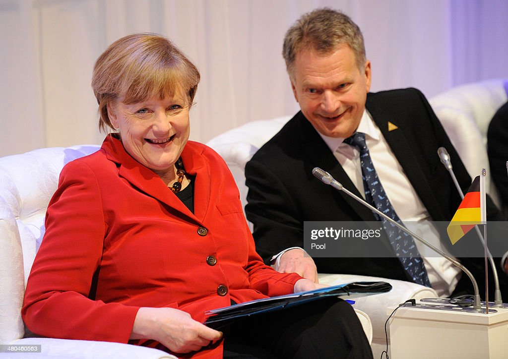 German Chancellor <a gi-track='captionPersonalityLinkClicked' href=/galleries/search?phrase=Angela+Merkel&family=editorial&specificpeople=202161 ng-click='$event.stopPropagation()'>Angela Merkel</a> and and Finnish President Sauli Niinisto attend an informal plenary at the 2014 Nuclear Security Summit on March 25, 2014 in The Hague, Netherlands. Leaders from around the world have come to discuss matters related to international nuclear security, though the summit has been overshadowed by recent events in Ukraine.