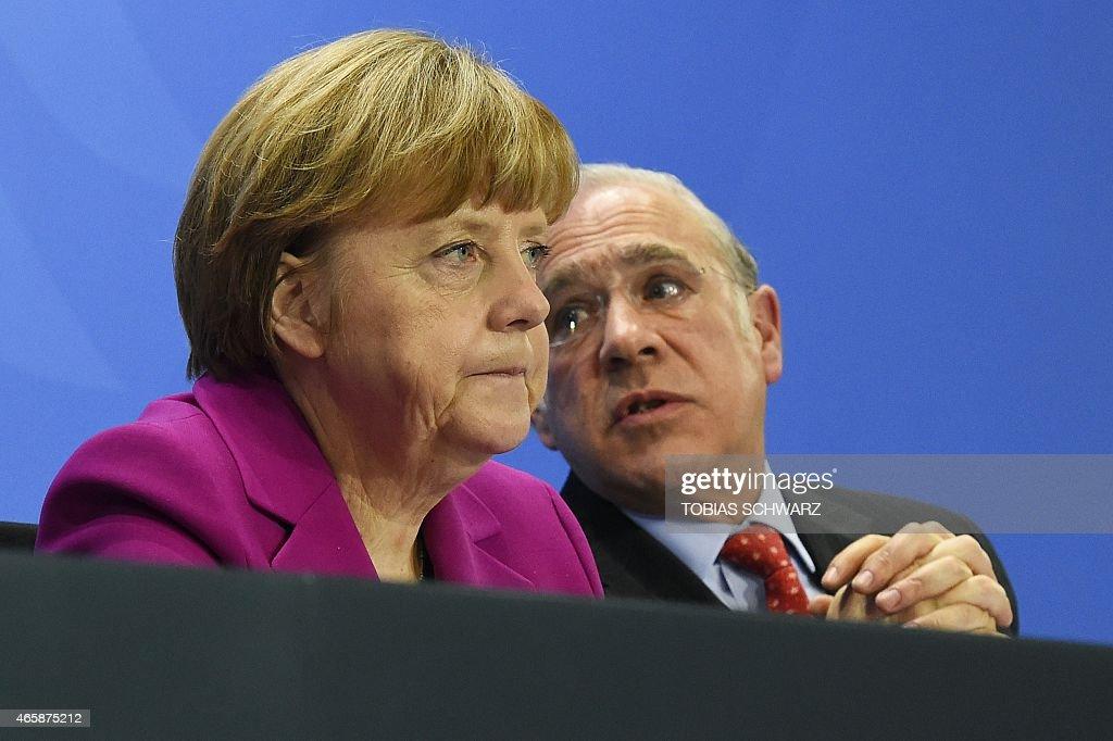 German Chancellor Angela Merkel and Angel Gurria SecretaryGeneral of the Organisation for Economic Cooperation and Development address a press...