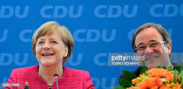 German Chancellor Angela Merkel and Armin Laschet top candidate of their conservative Chrisitan Democratic Union party for regional elections in the...
