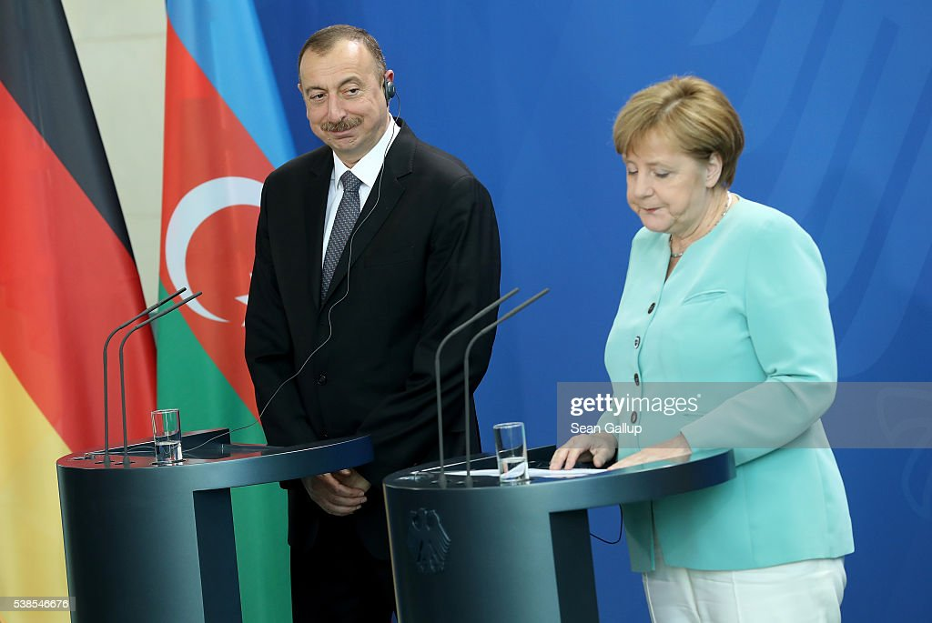 German Chancellor <a gi-track='captionPersonalityLinkClicked' href=/galleries/search?phrase=Angela+Merkel&family=editorial&specificpeople=202161 ng-click='$event.stopPropagation()'>Angela Merkel</a> and Azerbaijani President <a gi-track='captionPersonalityLinkClicked' href=/galleries/search?phrase=Ilham+Aliyev&family=editorial&specificpeople=565601 ng-click='$event.stopPropagation()'>Ilham Aliyev</a> speak to the media following talks at the Chancellery on June 7, 2016 in Berlin, Germany. The leaders discussed a variety of topics, including the simmering conflict between Azerbaijan and Armenia.