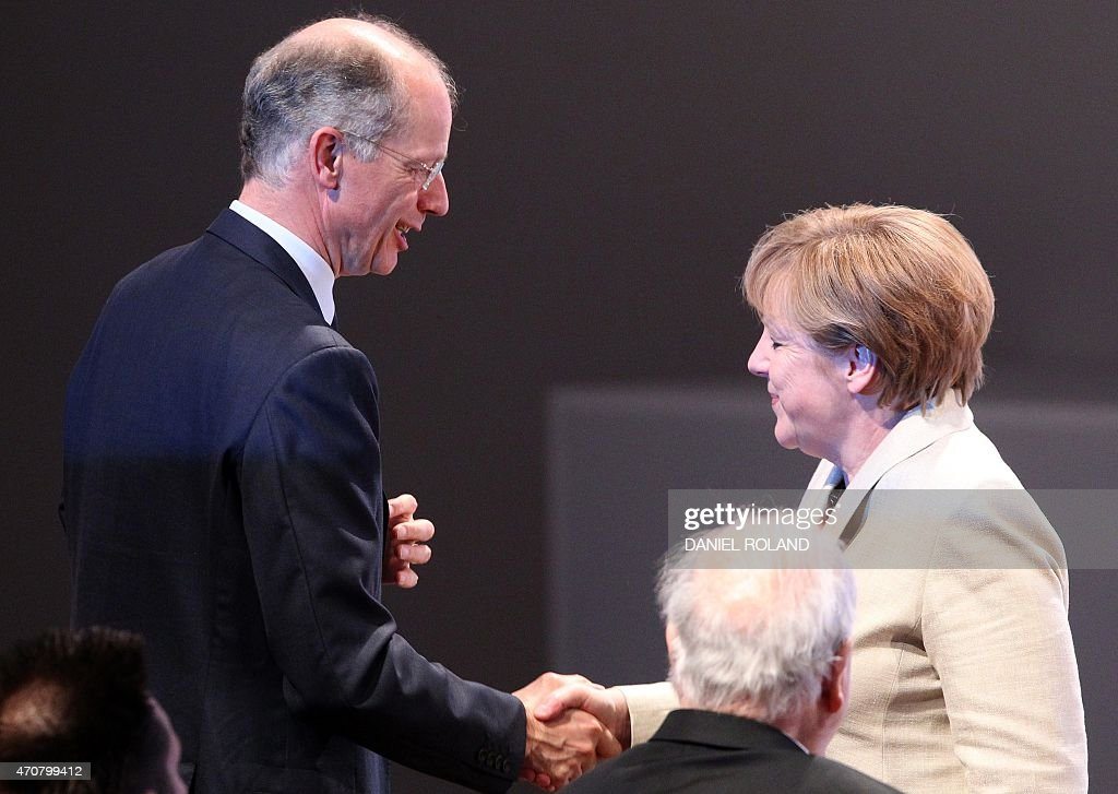 German chancellor Angela Merkel and BASF CEO Kurt Bock shake hands during an event to celebrate the 150th anniversary of German chemicals company...