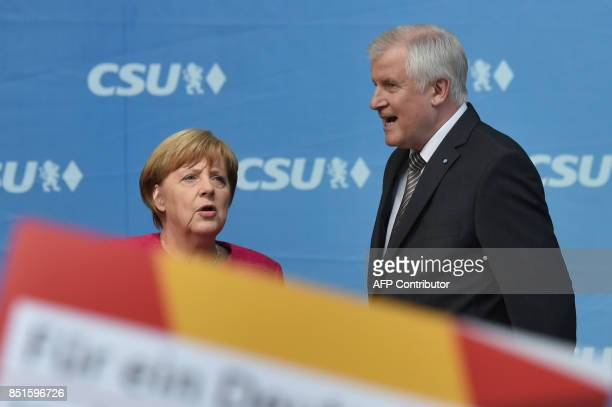 German Chancellor Angela Merkel and Bavarian State Premier and CSU party leader Horst Seehofer address an election campaign rally in Munich southern...