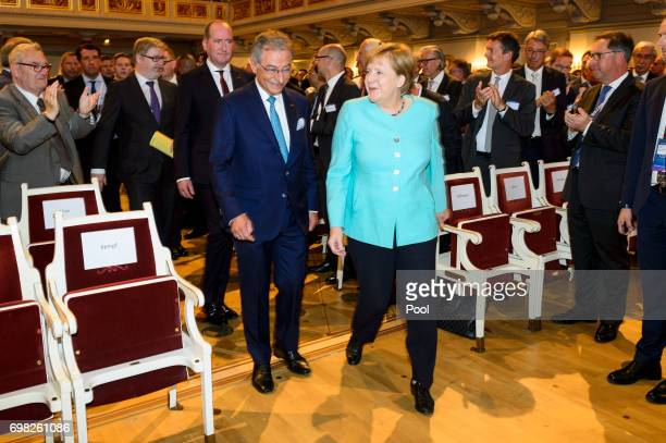 German Chancellor Angela Merkel and BDI President Dieter Kempf arrive for the German Federation of Industry's Annual Congress on June 20 2017 in...