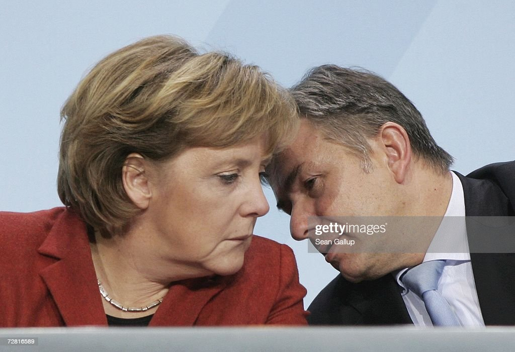 German Chancellor <a gi-track='captionPersonalityLinkClicked' href=/galleries/search?phrase=Angela+Merkel&family=editorial&specificpeople=202161 ng-click='$event.stopPropagation()'>Angela Merkel</a> and Berlin Mayor Klaus Wowereit speak at a press conference after a meeting of German state governors at the Chancellery December 13, 2006 in Berlin, Germany. State governors from across Germany met in Berlin to discuss, among other issues, reforms to the German federal system as well as a national ban on smoking in restaurants, bars, hospitals and schools. Recent legislation failed after lawmakers could not decide whether the ban is a federal or state-level issue.