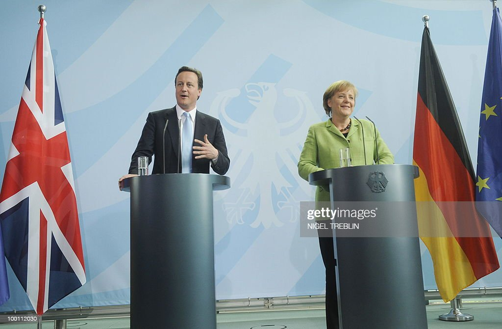 German Chancellor Angela Merkel and British Prime Minister David Cameron addresses a press conference at the Chancellery in Berlin on May 21, 2010. Cameron is on his first visit to Germany since becoming prime minister.