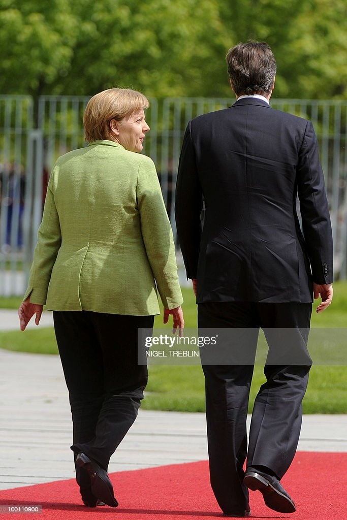 German Chancellor Angela Merkel and British Prime Minister David Cameron inspect an honour guard at the Chancellery in Berlin on May 21, 2010. Cameron is on his first visit to Germany since becoming prime minister.