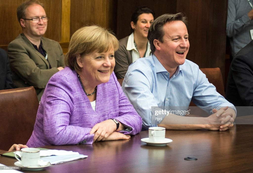 German Chancellor Angela Merkel and British Prime Minister David Cameron watch the UEFA Champions League Final between FC Bayern Muenchen and Chelsea FC during the 2012 G8 Summit at Camp David on May 19, 2012 in Camp David, Maryland. Leaders of eight of the worlds largest economies are meeting over the weekend in an effort to keep the lingering European debt crisis from spinning out of control.