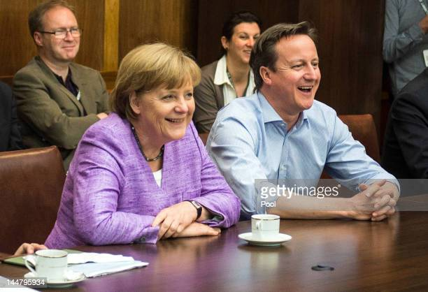 German Chancellor Angela Merkel and British Prime Minister David Cameron watch the UEFA Champions League Final between FC Bayern Muenchen and Chelsea...