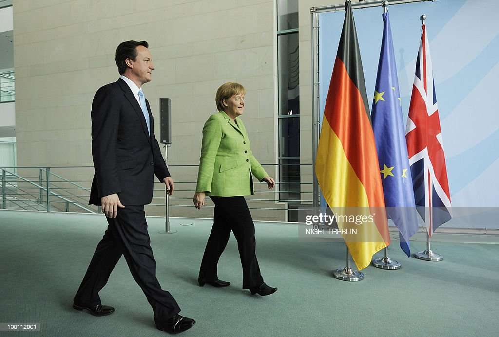 German Chancellor Angela Merkel and British Prime Minister David Cameron arrive to address a press conference at the Chancellery in Berlin on May 21, 2010. Cameron is on his first visit to Germany since becoming prime minister.