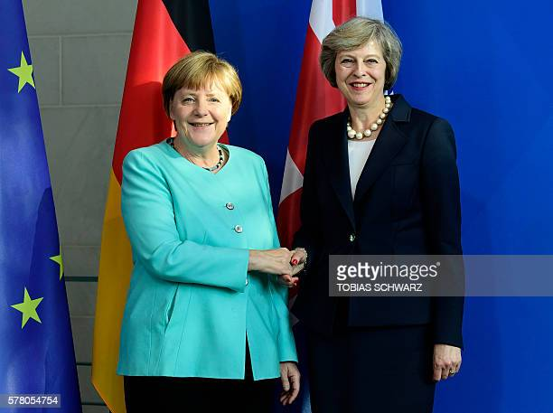 German Chancellor Angela Merkel and British Prime Minister Theresa May shake hands after a press conference after talks at the chancellery in Berlin...