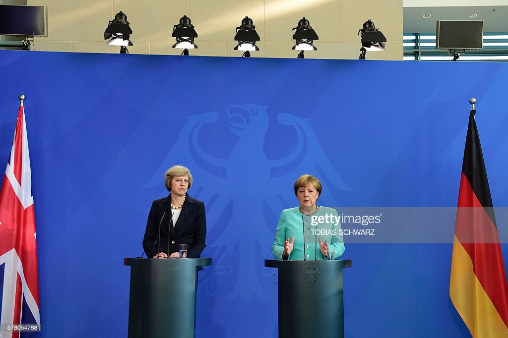 German Chancellor Angela Merkel (R) and British Prime Minister Theresa May address a press conference after talks at the chancellery in Berlin on July 20, 2016. / AFP / TOBIAS