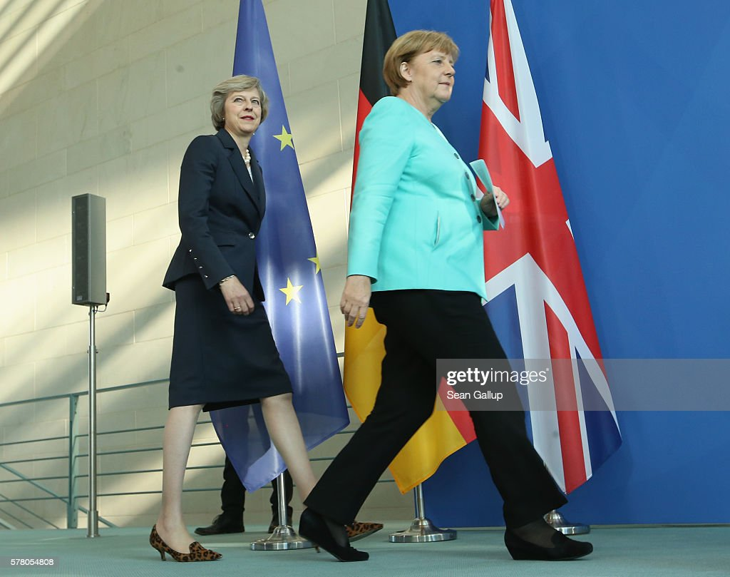German Chancellor Angela Merkel (R) and British Prime Minister Theresa May arrive to speak to the media following talks at the Chancellery on July 20, 2016 in Berlin, Germany. May, who replaced David Cameron as prime minister last week in the wake of the Brexit vote that will take the United Kingdom out of the European Union, is visiting Germany and France in her first foreign trip since assuming office.