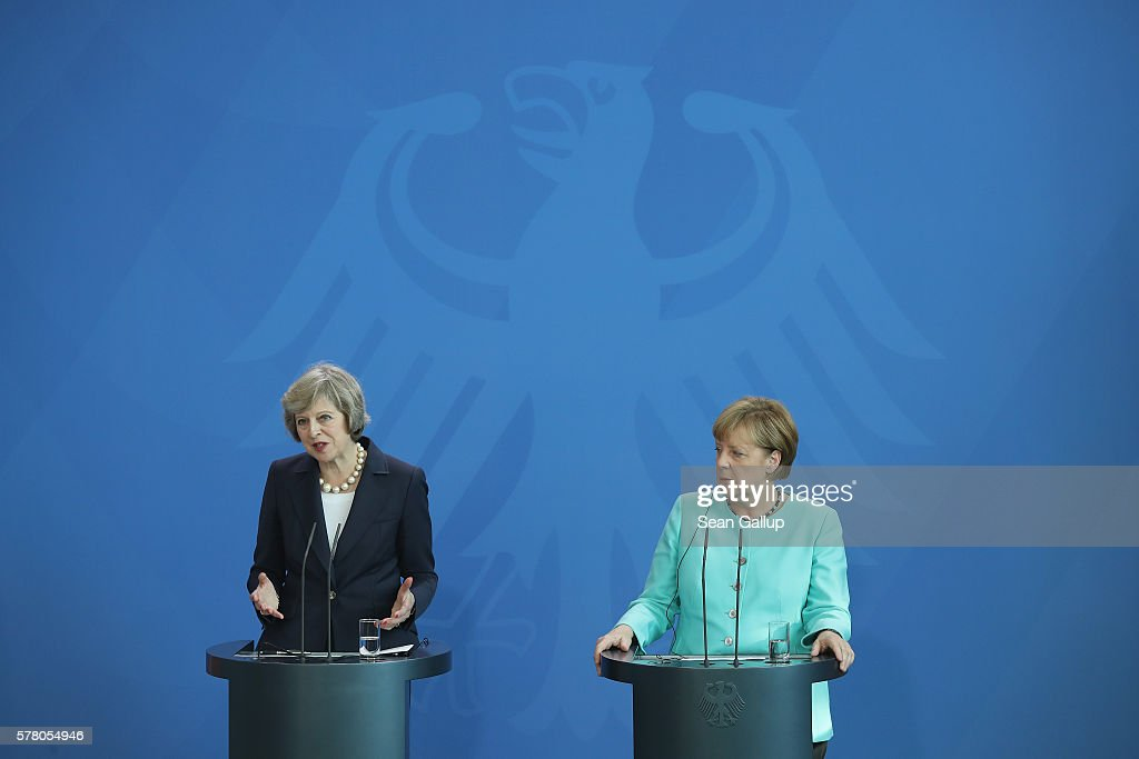 German Chancellor Angela Merkel (R) and British Prime Minister Theresa Mayspeak to the media under the German Federal Eagle following talks at the Chancellery on July 20, 2016 in Berlin, Germany. May, who replaced David Cameron as prime minister last week in the wake of the Brexit vote that will take the United Kingdom out of the European Union, is visiting Germany and France in her first foreign trip since assuming office.