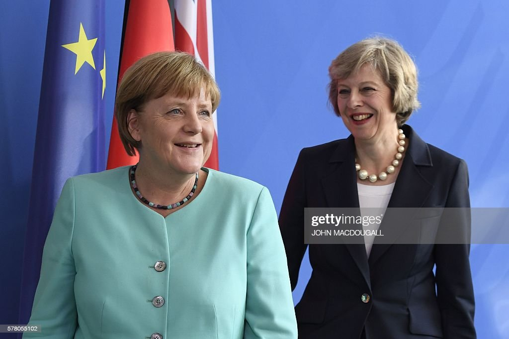 German Chancellor Angela Merkel (L) and British Prime Minister Theresa May leave after a press conference after talks at the chancellery in Berlin on July 20, 2016. / AFP / John MACDOUGALL