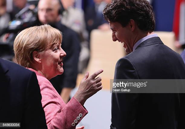 German Chancellor Angela Merkel and Canadian Prime Minister Justin Trudeau chat prior to the meeting of the NATOUkraine Commission at the Warsaw NATO...