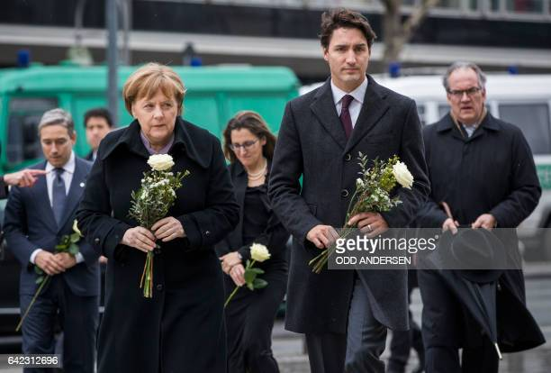 German Chancellor Angela Merkel and Canadian prime minister Justin Trudeau arrive to lay down flowers at a memorial to the victims of the...
