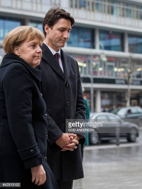 German Chancellor Angela Merkel and Canadian prime minister Justin Trudeau pay their respects at a memorial to the victims of the Breitscheidplatz...
