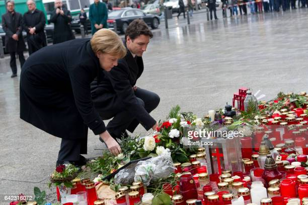 German Chancellor Angela Merkel and Canadian Prime Minister Justin Trudeau lay flowers at a memorial to the victims of the December Berlin terror...