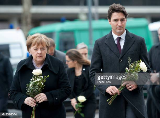 German Chancellor Angela Merkel and Canadian Prime Minister Justin Trudeau prepare to lay flowers at a memorial to the victims of the December Berlin...