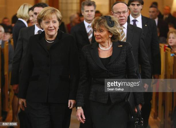 German Chancellor Angela Merkel and Central Council of Jews in Germany head Charlotte Knobloch arrive at a commemorative service for the 70th...