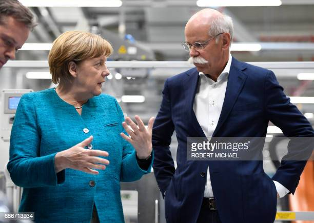 German Chancellor Angela Merkel and CEO of German carmaker Daimler and MercedesBenz Dieter Zetsche visit the new plant of the ACCUMOTIVE company...