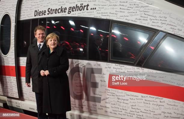 German Chancellor Angela Merkel and Chairman of German railway operator Deutsche Bahn Richard Lutz stand in front of an ICE high speed train at the...