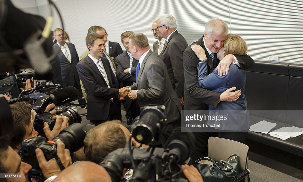 German Chancellor <a gi-track='captionPersonalityLinkClicked' href=/galleries/search?phrase=Angela+Merkel&family=editorial&specificpeople=202161 ng-click='$event.stopPropagation()'>Angela Merkel</a> (CDU) and Chairman of the Christian Social Union of Bavaria (CSU), <a gi-track='captionPersonalityLinkClicked' href=/galleries/search?phrase=Horst+Seehofer&family=editorial&specificpeople=4273631 ng-click='$event.stopPropagation()'>Horst Seehofer</a> hug before CDU/CSU parliamentary group's meeting at the lower house of parliament Bundestag on September 24, 2013 in Berlin, Germany.
