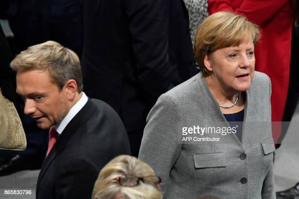German Chancellor Angela Merkel and Chairman of the Free Democratic Party Christian Lindner attend the first session of the newlyelected parliament...