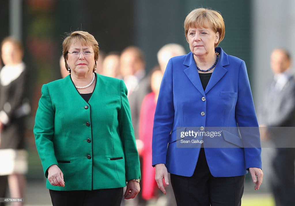 German Chancellor <a gi-track='captionPersonalityLinkClicked' href=/galleries/search?phrase=Angela+Merkel&family=editorial&specificpeople=202161 ng-click='$event.stopPropagation()'>Angela Merkel</a> (R) and Chilean President <a gi-track='captionPersonalityLinkClicked' href=/galleries/search?phrase=Michelle+Bachelet&family=editorial&specificpeople=547978 ng-click='$event.stopPropagation()'>Michelle Bachelet</a> review a guard of honour upon Bachelet's arrival at the Chancellery on October 27, 2014 in Berlin, Germany. Bachelet is on a two-day official visit to Germany, which includes a visit to Dresden, where Bachelet studied medicine as a student.