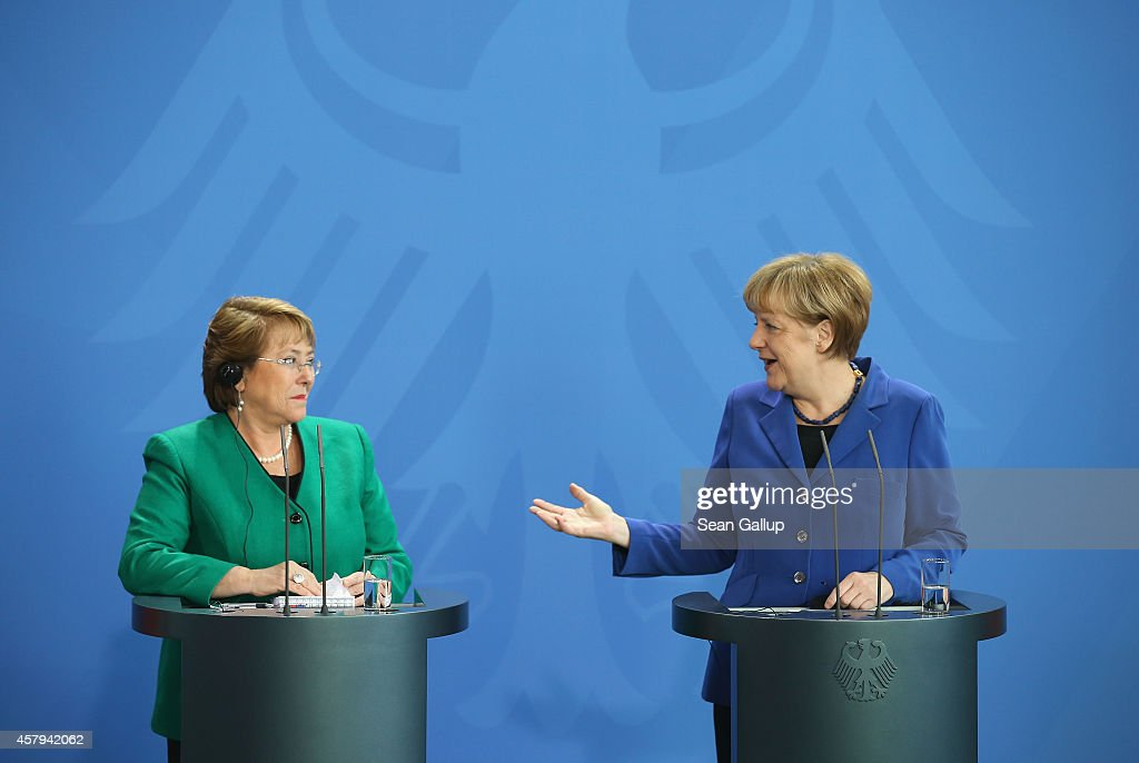 German Chancellor <a gi-track='captionPersonalityLinkClicked' href=/galleries/search?phrase=Angela+Merkel&family=editorial&specificpeople=202161 ng-click='$event.stopPropagation()'>Angela Merkel</a> (R) and Chilean President <a gi-track='captionPersonalityLinkClicked' href=/galleries/search?phrase=Michelle+Bachelet&family=editorial&specificpeople=547978 ng-click='$event.stopPropagation()'>Michelle Bachelet</a> speak to the media follwing talks at the Chancellery on October 27, 2014 in Berlin, Germany. Bachelet is on a two-day official visit to Germany, which includes a visit to Dresden, where Bachelet studied medicine as a student.
