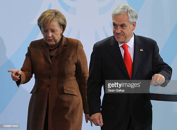 German Chancellor Angela Merkel and Chilean President Sebastian Pinera prepare to depart after speaking to the media following bilateral talks at the...