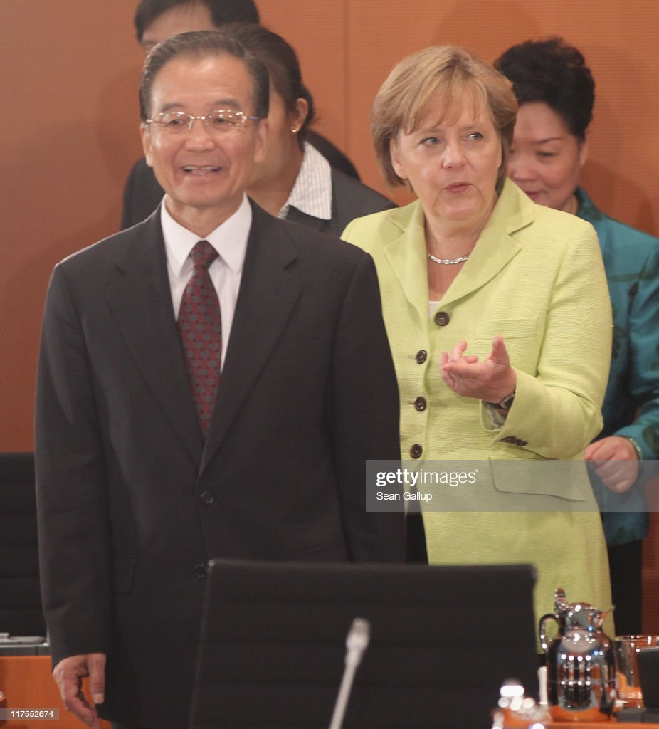 German Chancellor Angela Merkel and Chinese Premier Wen Jiabao arrive for talks at the Chancellery on June 28, 2011 in Berlin, Germany. The Chinese leader is visiting a variety of European countries and in Germany is participating in the first-ever German-Chinese government consultaitons.