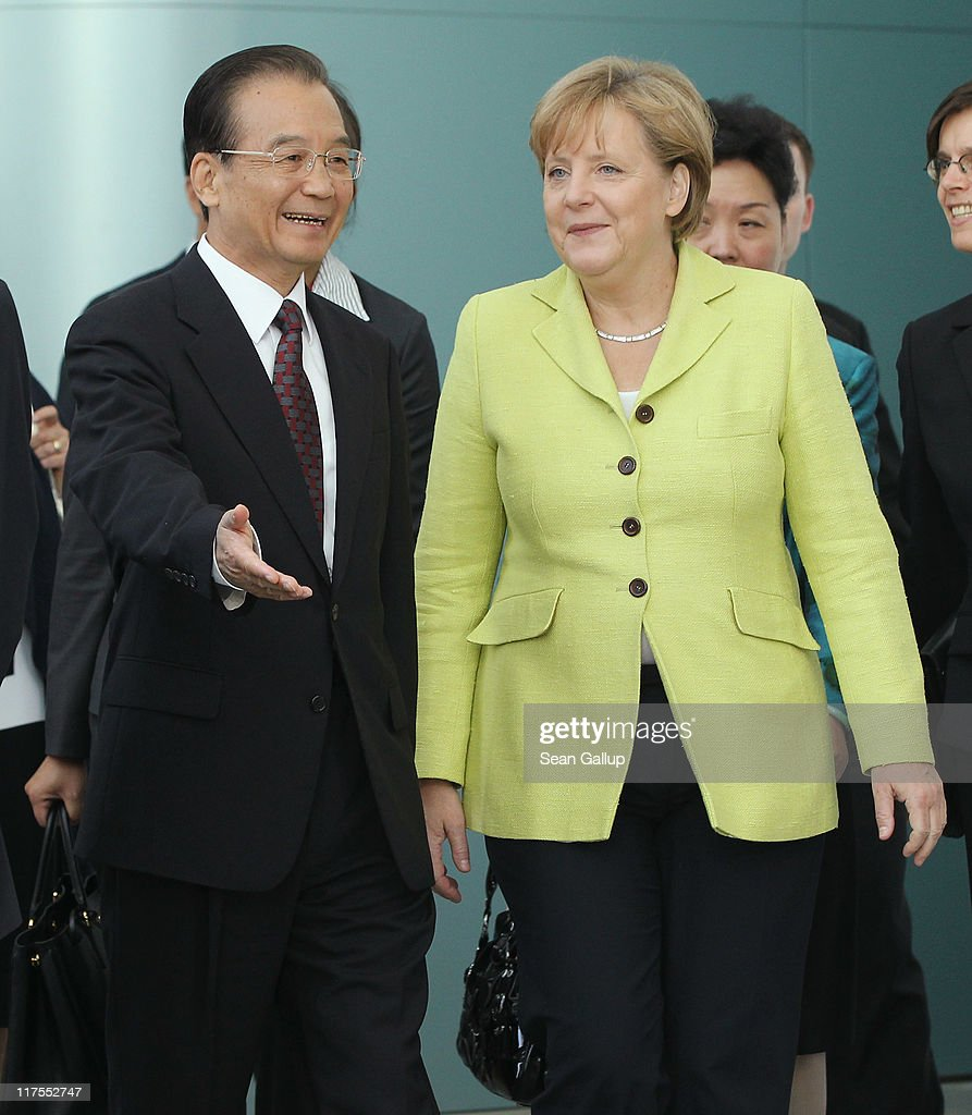 German Chancellor Angela Merkel and Chinese Premier Wen Jiabao arrive with government ministers of both countries for a group photo at the Chancellery on June 28, 2011 in Berlin, Germany. The Chinese leader is visiting a variety of European countries and in Germany is participating in the first-ever German-Chinese government consultaitons.