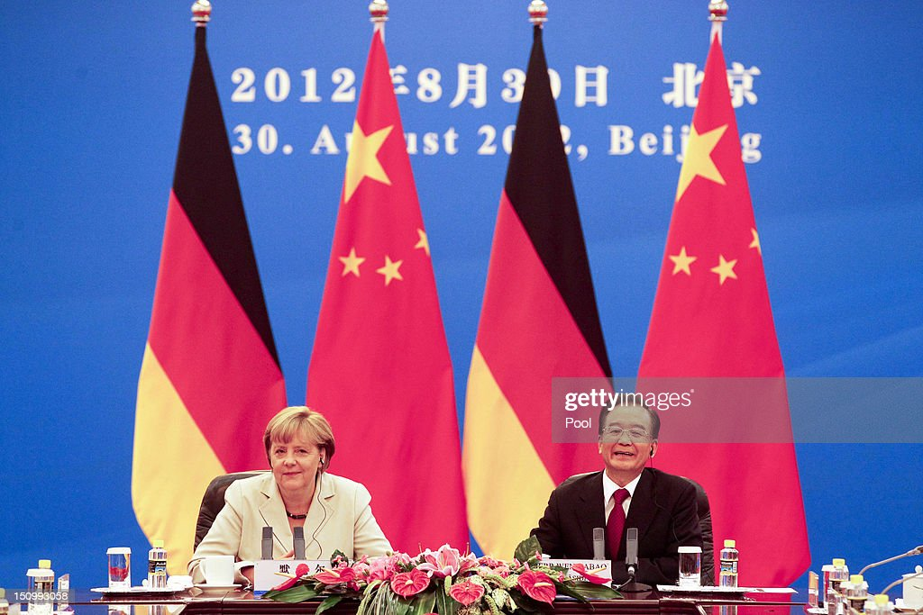 German Chancellor <a gi-track='captionPersonalityLinkClicked' href=/galleries/search?phrase=Angela+Merkel&family=editorial&specificpeople=202161 ng-click='$event.stopPropagation()'>Angela Merkel</a> (L) and Chinese Premier <a gi-track='captionPersonalityLinkClicked' href=/galleries/search?phrase=Wen+Jiabao&family=editorial&specificpeople=204598 ng-click='$event.stopPropagation()'>Wen Jiabao</a> hold bilateral talks inside the Great Hall of the People on August 30, 2012 in Beijing, China. Merkel is on a two-day official visit to China.