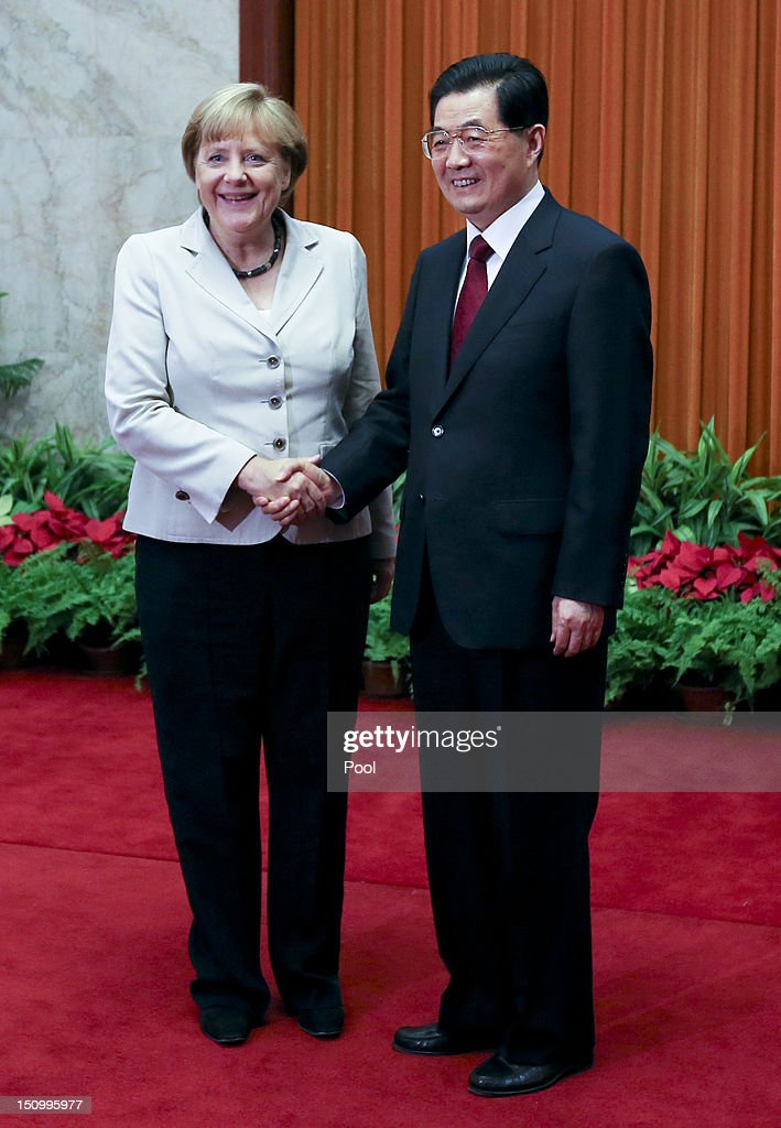 German Chancellor <a gi-track='captionPersonalityLinkClicked' href=/galleries/search?phrase=Angela+Merkel&family=editorial&specificpeople=202161 ng-click='$event.stopPropagation()'>Angela Merkel</a> (L) and Chinese President <a gi-track='captionPersonalityLinkClicked' href=/galleries/search?phrase=Hu+Jintao&family=editorial&specificpeople=203109 ng-click='$event.stopPropagation()'>Hu Jintao</a> shake hands before their meeting at the Great Hall of the People on August 30, 2012 in Beijing, China. Merkel is on a two-day official visit to China.
