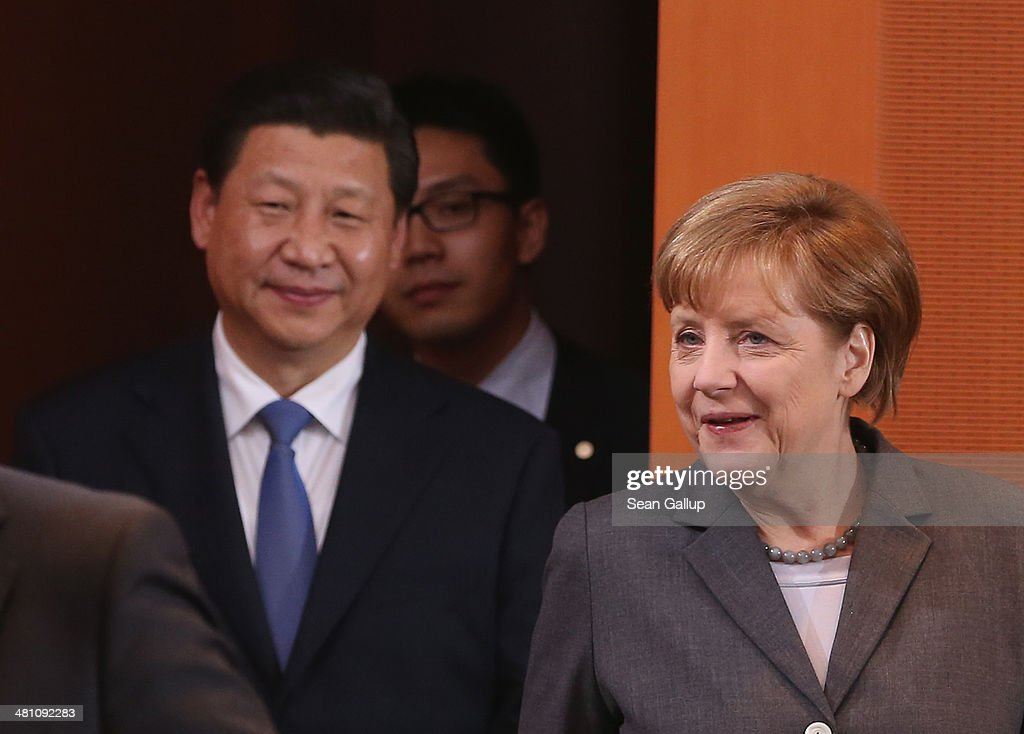 German Chancellor <a gi-track='captionPersonalityLinkClicked' href=/galleries/search?phrase=Angela+Merkel&family=editorial&specificpeople=202161 ng-click='$event.stopPropagation()'>Angela Merkel</a> (R) and Chinese President <a gi-track='captionPersonalityLinkClicked' href=/galleries/search?phrase=Xi+Jinping&family=editorial&specificpeople=2598986 ng-click='$event.stopPropagation()'>Xi Jinping</a> arrive for German-Chinese government talks at the Chancellery on March 28, 2014 in Berlin, Germany. President <a gi-track='captionPersonalityLinkClicked' href=/galleries/search?phrase=Xi+Jinping&family=editorial&specificpeople=2598986 ng-click='$event.stopPropagation()'>Xi Jinping</a> is on a two-day official visit to Germany.