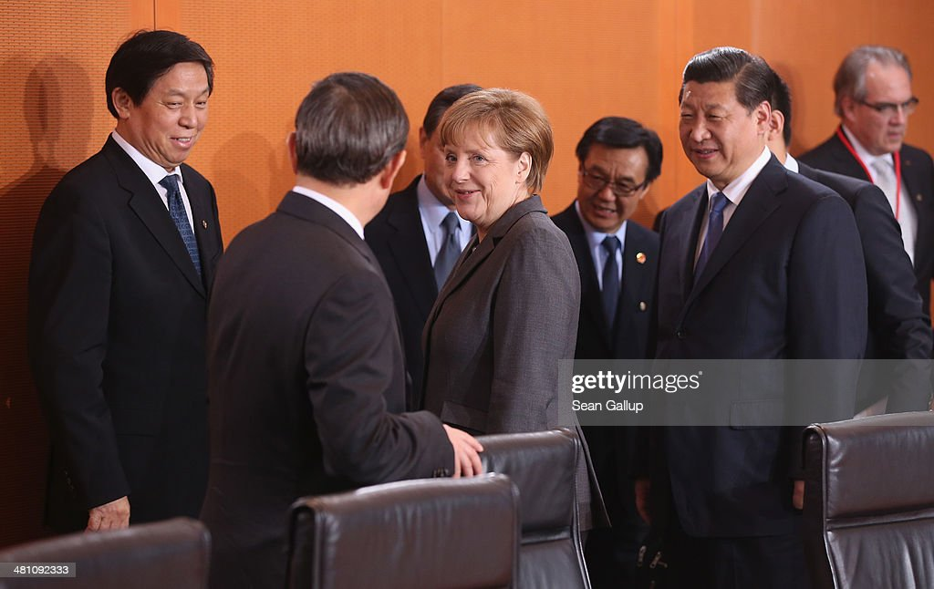 German Chancellor <a gi-track='captionPersonalityLinkClicked' href=/galleries/search?phrase=Angela+Merkel&family=editorial&specificpeople=202161 ng-click='$event.stopPropagation()'>Angela Merkel</a> (C) and Chinese President <a gi-track='captionPersonalityLinkClicked' href=/galleries/search?phrase=Xi+Jinping&family=editorial&specificpeople=2598986 ng-click='$event.stopPropagation()'>Xi Jinping</a> (R) arrive for German-Chinese government talks at the Chancellery on March 28, 2014 in Berlin, Germany. President <a gi-track='captionPersonalityLinkClicked' href=/galleries/search?phrase=Xi+Jinping&family=editorial&specificpeople=2598986 ng-click='$event.stopPropagation()'>Xi Jinping</a> is on a two-day official visit to Germany.