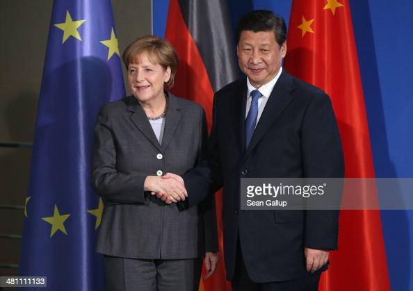 German Chancellor Angela Merkel and Chinese President Xi Jinping shake hands after speaking to the media following talks and the signing of bilateral...